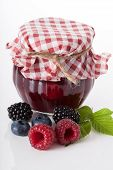 stock photo of jar jelly  - Jar of berry jam on white isolated background - JPG