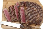 High angle view of a partly-sliced grilled wagyu beef ribeye steak viewed from above