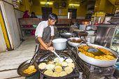 Local Man Prepares Bakery In A Pan