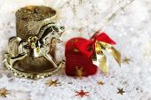 stock photo of christmas song  - The Christmas song with a toy horse and a gift - JPG