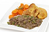 Minced beef cooked with onion, garlic, peas and herbs, served with sauteed potatoes and boiled carro