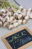 Fresh Pulled Garlic For Sale At The Farmers Market
