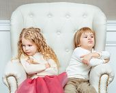 stock photo of sulky  - Cute little siblings  - JPG
