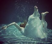 Girl in Dress Diving Underwater