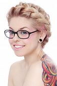Portrait of young beautiful smiling freaky girl in glasses over white background