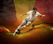 Abstract waves aroun soccer player on the national flag of Belgium background