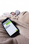 foto of goodnight  - cell phone screen showing text messages while male is in bed - JPG