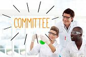 The word committee against scientists working in laboratory