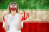 Excited iran fan in face paint cheering against iran flag in grunge effect