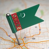 stock photo of turkmenistan  - Small Flag of Turkmenistan on a Map Background with Selective Focus - JPG