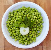 Plate of fresh cut green peas