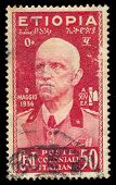 ITALY - CIRCA 1936: A stamp printed in Italy shows the Emperor Victor Emmanuel III 9 May 1936 to com