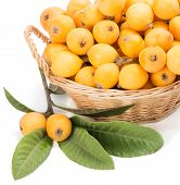 picture of loquat  - Wicker baskets with loquats isolated on a white - JPG