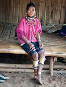 CHIANG RAI, THAILAND - DEC 4, 2013: Unidentified Karen hill tribe woman in her home in traditional c