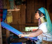 MAE HONG SON, CHIANG MAI, THAILAND - DEC 4, 2013: Unidentified Karen Long Neck woman in traditional hill tribe village also known as Kayan indigenous  ethnic group. Famous tourist travel destination.