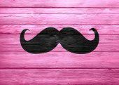 Black Mustache On Wood Texture Pink
