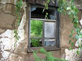 Ruinous Wall And Window Of House