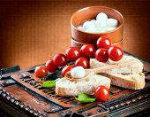 Mozzarella tomatoes and bread. Italian food