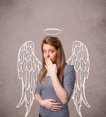 stock photo of little angel  - Cute girl with angel illustrated wings on grungy background - JPG