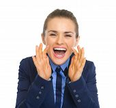 Happy Business Woman Shouting Through Megaphone Shaped Hands
