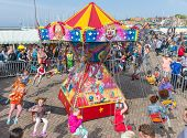 Children Have Fun In A Carousel At A Dutch National Holiday