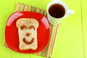 Funny toast, on color wooden background