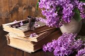 foto of interpreter  - Beautiful composition with old keys and old books on wooden background - JPG