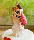 Wedding Cake Topper Depicting One Man with Several Women