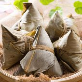 Rice dumpling or zongzi. Traditional steamed sticky glutinous rice dumplings. Chinese food dim sum.