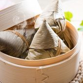Hot rice dumpling or zongzi. Traditional steamed sticky glutinous rice dumplings. Chinese food dim s