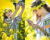 Young girl wearing Romanian traditional blouse taking selfie in canola field, outdoor shot