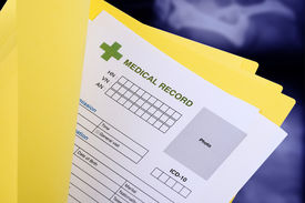 pic of x-files  - Blank medical record in yellow folder on x-ray film background. ** Note: Shallow depth of field - JPG