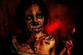 foto of bloody  - Scary bloody zombie girl with an ax - JPG