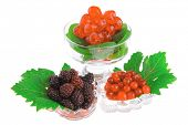 served berrys in transparent glass over white