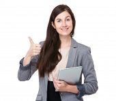 Business woman with tablet and thumb up