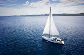Yacht sailing on open sea at windy day