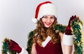 Beautiful woman in a red dress and hat of Santa