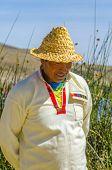 PUNO, PERU, MAY 5, 2014:  Inhabitant of Uros Islands in traditional attire