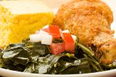 foto of fried chicken  - Fried Chicken served with collard greens and cornbread