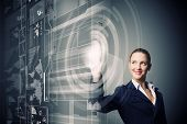 Attractive businesswoman touching icon of media screen