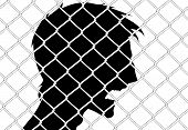 angry man behind wire