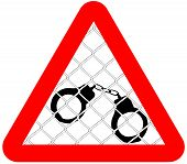 attention sign handcuffed behind wire