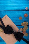 Marine Theme Blue Background. Tie Bow And Money From The Mail Envelope