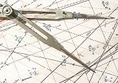 Old Compass On A Navigation Chart