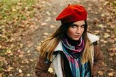 stock photo of beret  - Beautiful young girl with a red beret - JPG