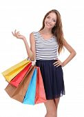 Beautiful young woman with shopping bags isolated on white
