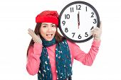 Asian Girl Wear  Red Christmas Hat Excited With Clock At Midnight