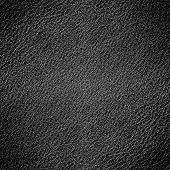 Perspective and closeup view to abstract dark space of empty black natural clean leather texture for the traditional business background in luxury grunge color