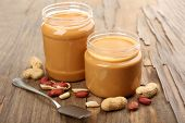 Creamy peanut butter on wooden table