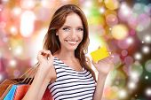 Shopping concept. Beautiful young woman with shopping bags on shop background
